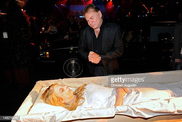 Fritz Wepper looks at a corpse in a casket shown by a model during SKY launch event Party at Schuppen 52 on May 23 2012 in Hamburg Germany