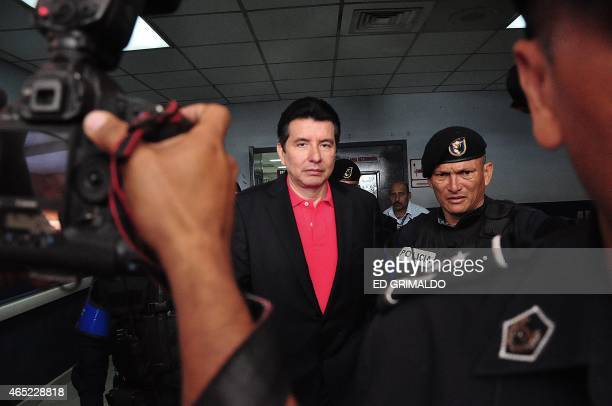 Frmer judge of the Supreme Court of Panama Alejandro Moncada Luna is escorted by police in the Santa Tomas Hospital in Panama City on March 4 2015...