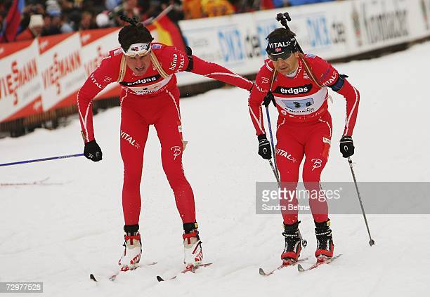 Frode Andresen of Norway changes with his team mate Ole Einar Bjoerndalen during the men's 4x7.5 km relay in the Biathlon World Cup on January 11,...