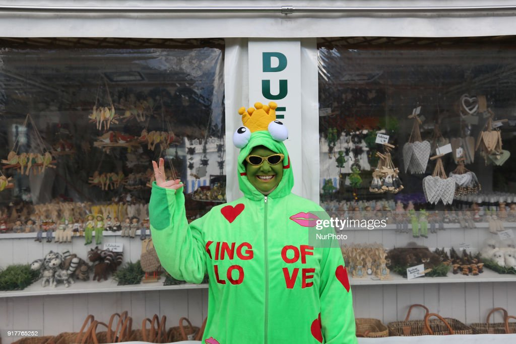 """A frog prince is seen in the Munich Carnival. On the costume there's written """"King of love""""."""