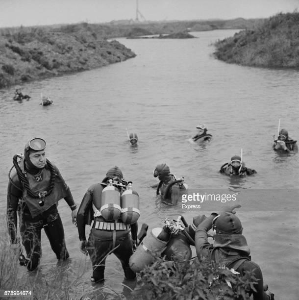 Frogmen searching gravel pits looking for missing Brenda Nash 12 year old girl who was murdered by Arthur Albert Jones UK November 1960