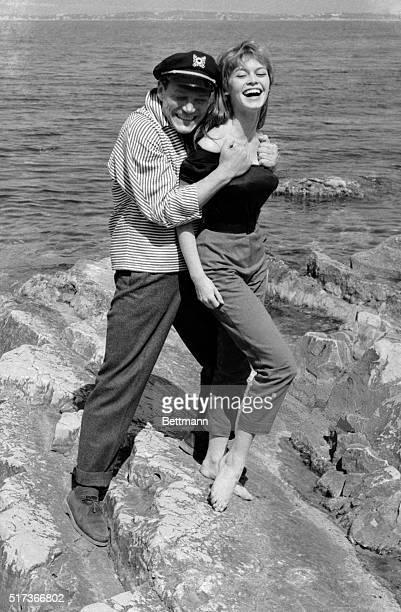 Frolicking on the rocks at Cannes are French movie 'Tough guy' Eddie Constantine and Starlet Brigitte Bardot who obviously doesn't 'scare' easily...