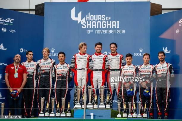 Second placed Toyota drivers Sebastien Buemi of Switzerland Brendon Hartley of New Zealand and Kazuki Nakajima of Japan winners Gustavo Menezes of...