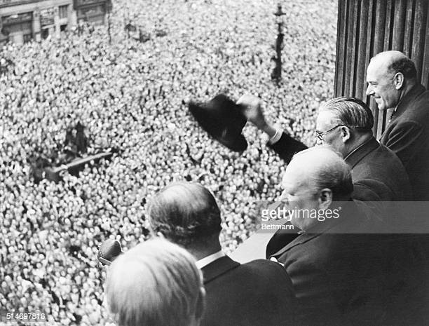 From a balcony in the Ministry of Health Building in Whitehall, Mr. Churchill addresses a huge crowd, 8th May 1945. Members of the cabinet were with...