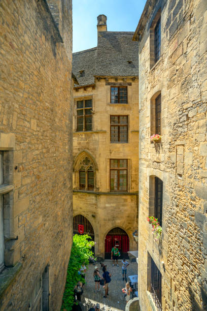 "From a upper part of a narrow street with view of the ""Maison des Consuls"" or ""Hôtel de Plamon"" or ""Hôtel de Tapinois de Beton"" (they bear all these names) in Sarlat-la-Canéda, Dordogne"