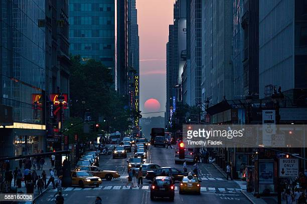 From a view looking west along 42nd Street in New York for just 10 minutes the sun sets in exact alignment with the cross streets of Manhattan's...