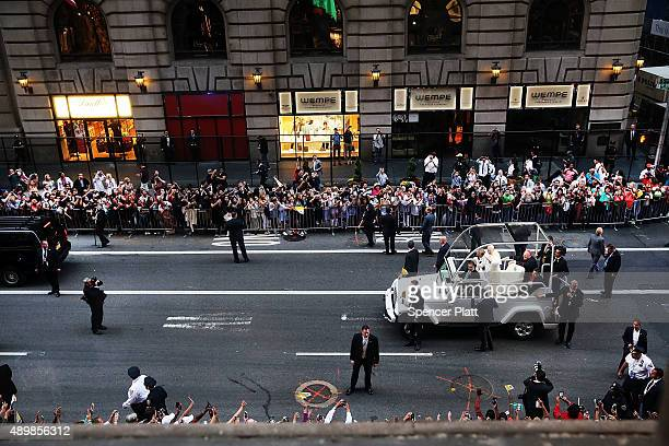 From a window st the St Regis Hotel Pope Francis is viewed as he makes his way down 5th Avenue towards St Patricks Cathedral on September 24 2015 in...