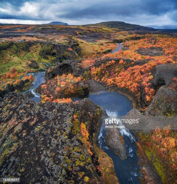 From above lava and moss landscape in the autumn, Gjaarfoss in the Thjorsardalur valley, Iceland. This image is shot with a drone.