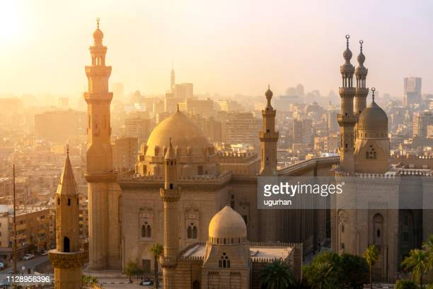 from above view of the mosques of sultan hassan and al-rifai. - cairo stock pictures, royalty-free photos & images