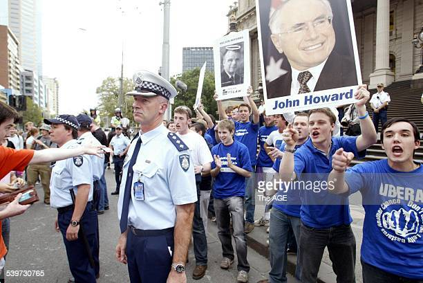 From behind Police lines Young Liberal students heckle students National Day of Action oppose Voluntary Student Unionism in street march Bourke St...