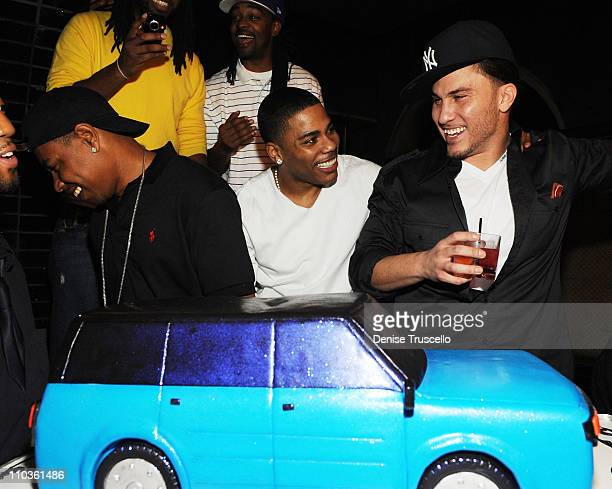 From bottom row left City Spud, Nelly, Avery Storm, top row Kyjuan and Murphy Lee attend Nelly's surprise birthday party at Lavo Restaurant and...