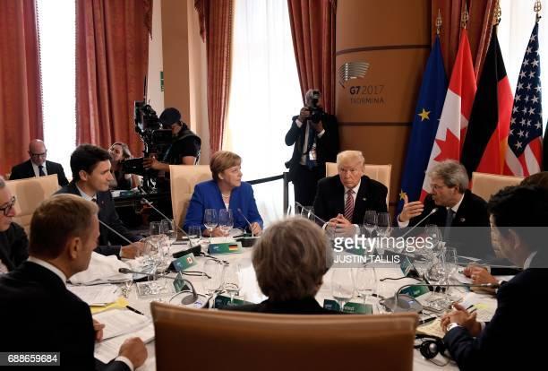 German Chancellor Angela Merkel US President Donald Trump Italian Prime Minister Paolo Gentiloni Japanese Prime Minister Shinzo Abe Britain's Prime...