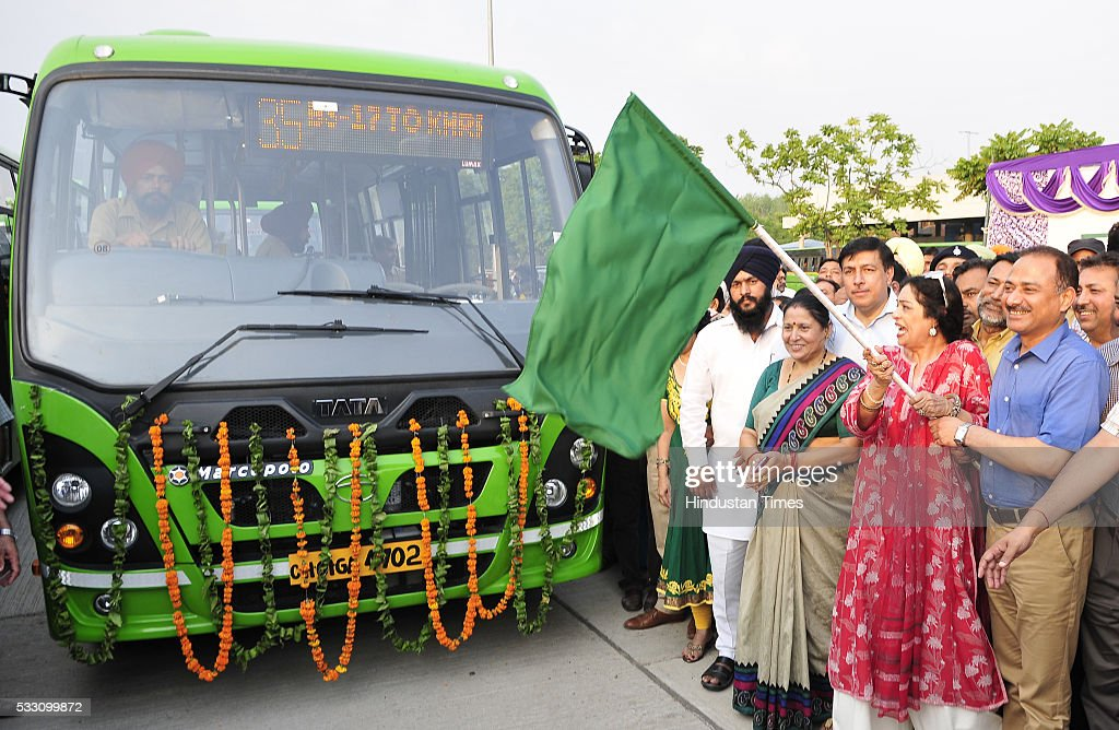 MP from Chandigarh Kirron Kher with mayor Arun Sood flagging off New 49 Midi Buses at ISBT Sector43 on May 20 2016 in Chandigarh India With the...