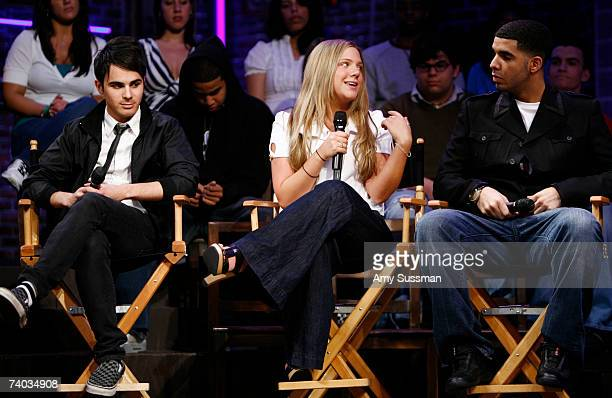 From Degrassi Adamo Ruggiero Lauren Collins and Aubrey Graham speak at the Spring Awakening and Degrassi panel discussion with Rosie O'Donnell at the...