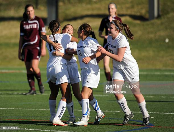 From front left Kent Denver Havana McElvaine Natalie Ricci Aurie Pike and Krista D'Alessandro celebrate Ricci's winning goal of the game against...
