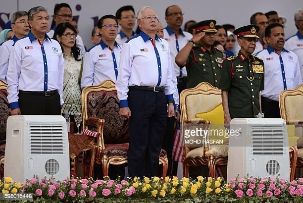Malaysian Deputy Prime Minister Ahmad Zahid Hamidi, Malaysia's Prime Minister Najib Razak, and Malaysia's King Abdul Halim Mu'adzam Shah observe the...