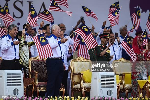 Malaysia's Deputy Prime Minister Ahmad Zahid Hamidi, Malaysia's Prime Minister Najib Razak, Malaysia's King Abdul Halim Mu'adzam Shah and Queen...