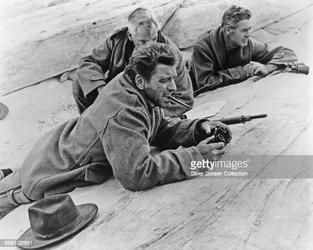 From front to back actors Burt Lancaster as Bill Dolworth Lee Marvin as Rico Fardan and Robert Ryan as Hans Ehrengard in the film 'The Professionals'...