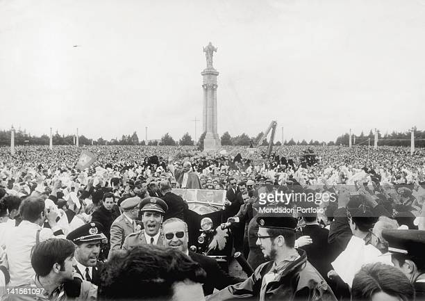 From his car Pope Paul VI born Giovanni Montini waving to the faithful crowding the square of the Sanctuary Fatima 13th May 1967