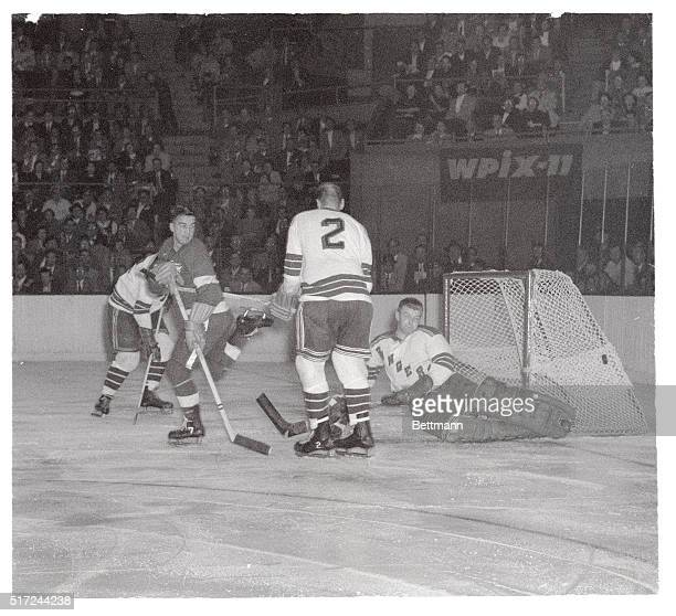 From his stance it would be easy to assume that Detroit Red Wings' forward Ted Lindsay is a bit irked as New York Rangers' goalie Lorne Worsley...