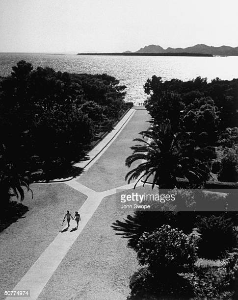 From Hotel du Cap d' Antibes looking down promenade leading to Pavilion Eden Roc and the sea