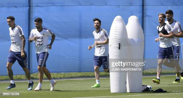 Argentina's footballers Angel Di Maria Ever Banega Lionel Messi Cristian Ansaldi and Federico Fazio jog during a training session at the team's base...
