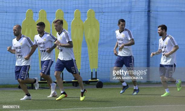 Argentina's footballers Javier Mascherano Ever Banega Lucas Biglia Angel Di Maria and Lionel Messi jog during a training session at the team's base...