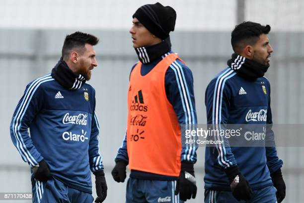Argentina's Lionel Messi Paulo Dybala and Sergio Aguero take part in a training session in Moscow on November 7 2017 The team will face Russia in...