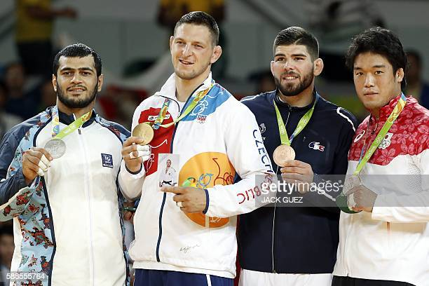 Azerbaijan's Elmar Gasimov Czech Republic's Lukas Krpalek France's Cyrille Maret and Japan's Ryunosuke Haga celebrate on the podium of the men's...