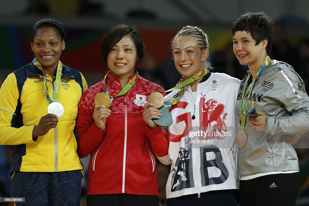 Colombia's Yuri Alvear (silver), Japan's Haruka Tachimoto (gold), Great Britain's Sally Conway (bronze) and Germany's Laura Vargas Koch (bronze) celebrate with their medals on the podium of the women's -70kg judo contest of the Rio 2016 Olympic Games in Rio de Janeiro on August 10, 2016. / AFP / Jack GUEZ