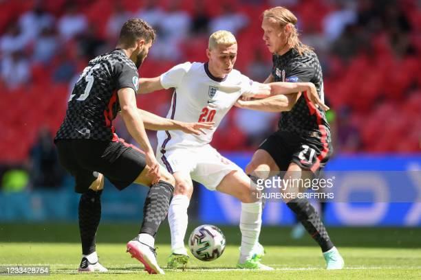 Croatia's defender Josko Gvardiol, England's midfielder Phil Foden and Croatia's defender Domagoj Vida vie for the ball during the UEFA EURO 2020...