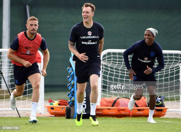 England's midfielder Jordan Henderson England's defender Phil Jones and England's defender Ashley Young take part in a training session at Stadium...
