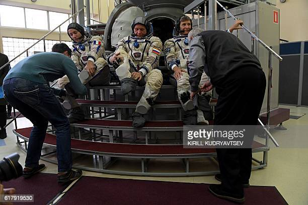 France's astronaut Thomas Pesquet Russia's cosmonaut Oleg Novitsky and US astronaut Peggy Whitson take part in an examination training session on a...