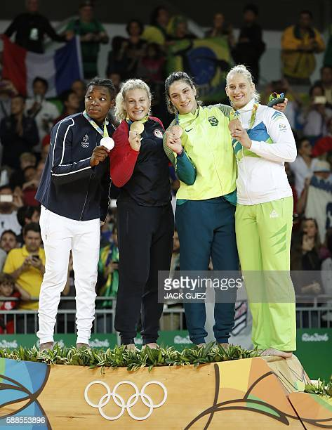 France's Audrey Tcheumeo US Kayla Harrison Brazil's Mayra Aguiar and Slovenia's Anamari Velensek celebrate on the podium of the women's 78kg judo...