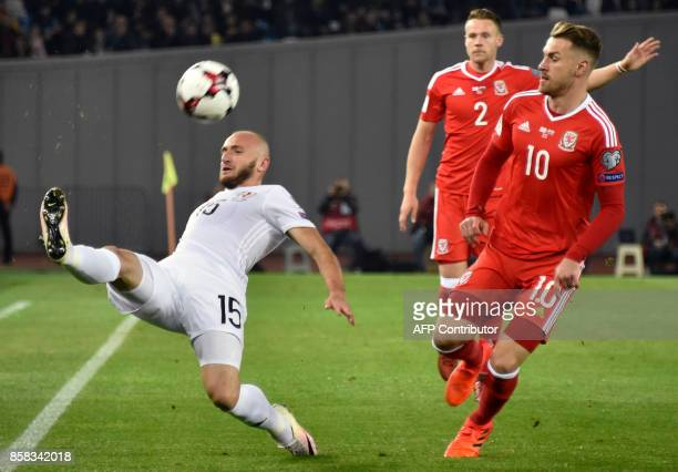 Georgia's midfielder Valeri Gvilia Wales' defender Chris Gunter and Wales' midfielder Aaron Ramsey vie for the ball during the FIFA World Cup 2018...
