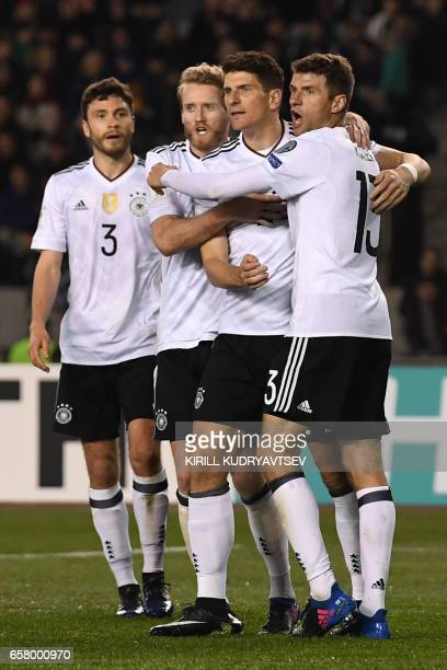 Germany's Jonas Hector Andre Schuerrle Mario Gomez and Thomas Mueller celebrate a goal during the FIFA World Cup 2018 qualification football match...
