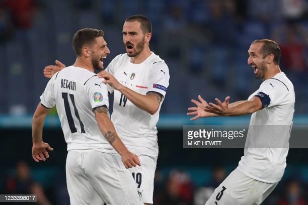Italy's forward Domenico Berardi, Italy's defender Leonardo Bonucci and Italy's defender Giorgio Chiellini celebrate after Turkey's defender Merih...