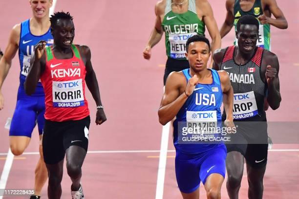 Kenya's Emmanuel Kipkurui Korir, USA's Donavan Brazier and Canada's Marco Arop compete in the Men's 800m semi-final at the 2019 IAAF World Athletics...