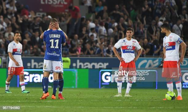 From L Lyon's French defender Jeremy Morel Lyon's forward Houssem Aouar and Lyon's French midfielder Nabil Fekir react as Strasbourg's French...