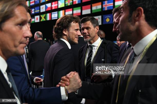 Miguel Salgado Diego Forlan FIFA Deputy Secretary General Zvonimir Boban and Luis Figo attend the 68th FIFA Congress at the Expocentre in Moscow on...