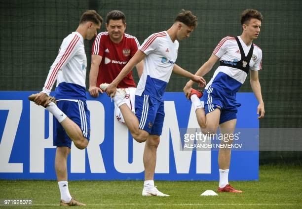 Russia's forward Alexey Miranchuk Russia's midfielder Anton Miranchuk and Russia's midfielder Alexander Golovin attend a training session in...