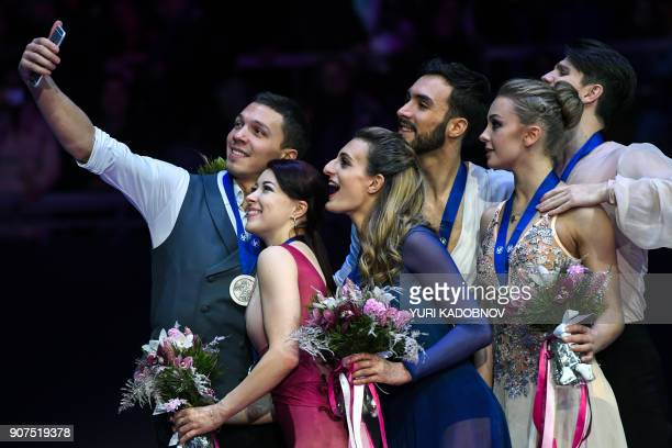 Silver medallists Ekaterina Bobrova and Dmitri Soloviev of Russia gold medallists Gabriella Papadakis and Guillaume Cizeron of France and bronze...