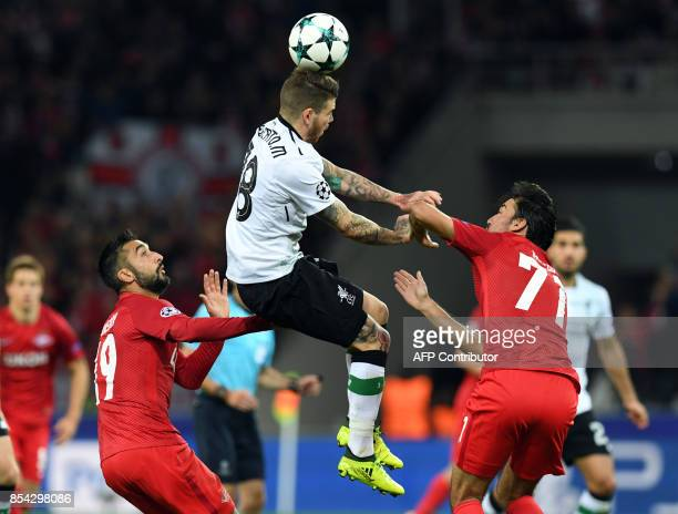 Spartak Moscow's midfielder from Russia Alexander Samedov Liverpool's defender from Spain Alberto Moreno and Spartak Moscow's midfielder from...
