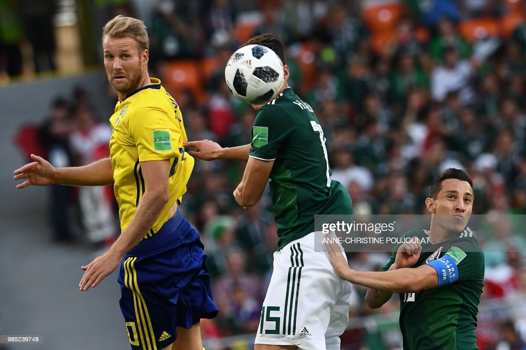Sweden's forward Ola Toivonen, Mexico's defender Hector Moreno and Mexico's midfielder Andres Guardado in action during the Russia 2018 World Cup Group F football match between Mexico and Sweden at the Ekaterinburg Arena in Ekaterinburg on June 27, 2018. (Photo by Anne-Christine POUJOULAT / AFP) / RESTRICTED