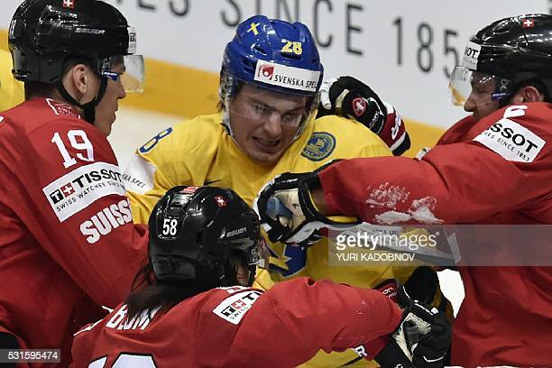 Switzerland's forward Reto Schappi Switzerland's defender Eric Blum and Switzerland's defender Yannick Weber vie with Sweden's forward Johan...