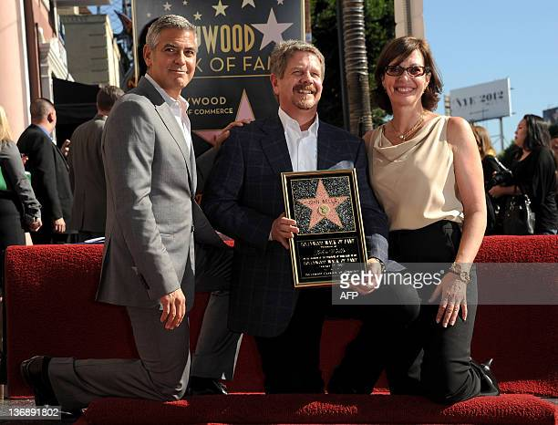 Actor George Clooney producer John Wells and actress Allison Janney attend the ceremony honoring Wells with a Star on The Hollywood Walk of Fame held...