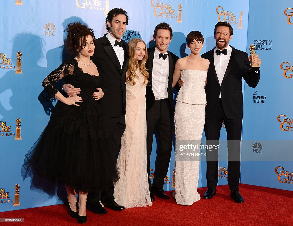 From L to R, actors Helena Bonham Carter, Sacha Baron Cohen, Amanda Seyfried, Eddie Redmayne, Anne Hathaway and Hugh Jackman pose with the best motion picture comedy or musical award for 'Les Miserables' in the press room at the Golden Globes awards ceremony in Beverly Hills on January 13, 2013. AFP PHOTO/Robyn BECK