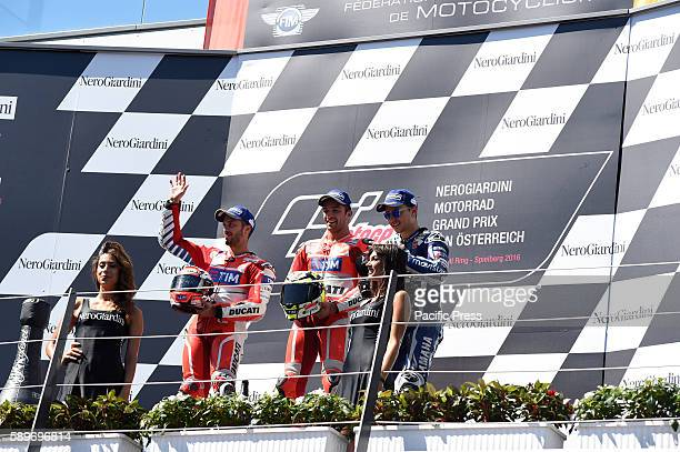 from L to R Andrea DoviziosoAndrea Iannone and Jorge Lorenzo on podium celebrate the victory at Austrian motogp The result turn out that Andrea...