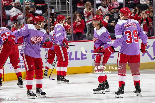 From L to R Andreas Athanasiou Tyler Bertuzzi and Anthony Mantha of the Detroit Red Wings flip the puck back and fourth prior to an NHL game against...