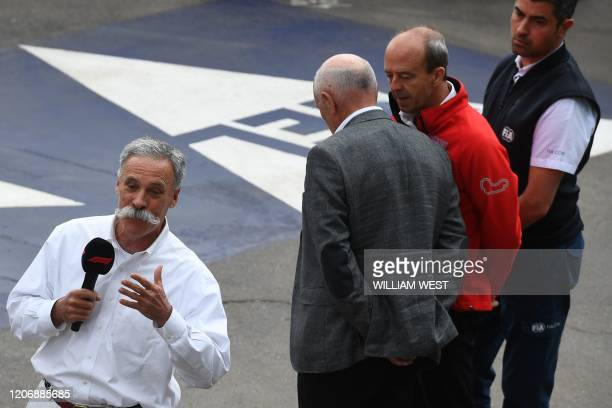 Chase Carey, Chief Executive Officer of the Formula One Group, speaks as Paul Little, chairman of the Australian Grand Prix Corporation, Andrew...